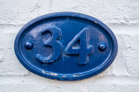 34: house plaque number 34 Stock Photo