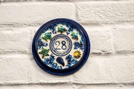 28: house plaque number 28