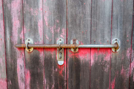 locking: A rusted metal locking mechnisem on an old door