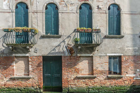 An old Venician house with five window and a door