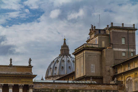 The vatican dome peaking in the background on a cloudy day