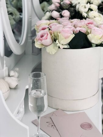 Wedding decor flower with mirror and invitation on the white table