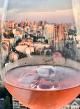 wineglasses with champagne and ice in the and beautiful city view