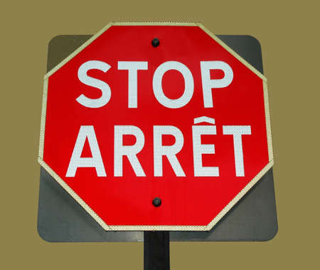 bilingual: bilingual stop sign on creme background