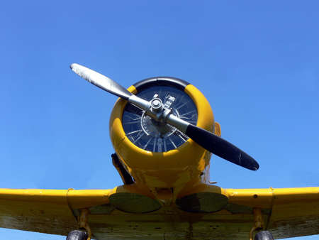 yellow airplane from world war 2 on blue sky