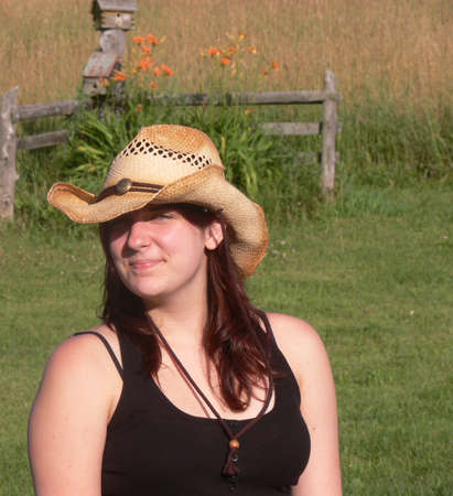 fresh looking country girl with straw hat  Stock Photo - 4366880