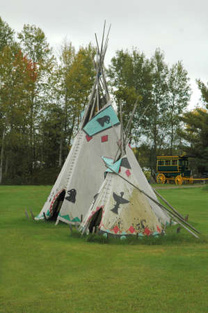 tipi: two teepee and stage coach with wooden wheels