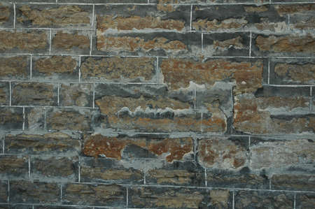 aging: aging brick wall with discolored bricks background