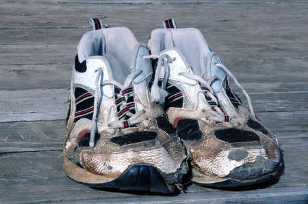 worn and tired running shoes Stock Photo