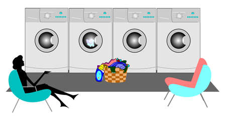 laundromat: lady sitting in laundromat doing wash
