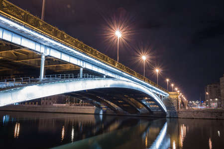 long night: Bridge over the river, night lights with long exposure Stock Photo