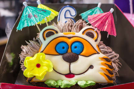 beautiful birthday cake with cream, baked design in the form of an animal hedgehog Stock Photo