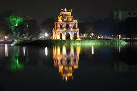 Turtle Tower at night on Hoan Kiem Lake. Hanoi, Vietnam.  Stock Photo