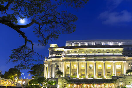 fool moon: Fool Moon. Center of Singapore, evening in city.