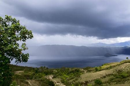 rainfall: Rainfall. Lake Toba View. Island on North Sumatra, Indonesia.