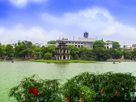 Turtle Tower and Red Lotuses in Sword Lake. Hanoi  Vietnam.  Stock Photo