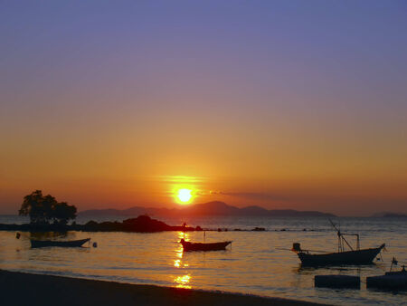 amat: Silent Water on Wong Amat Beach Sundown. Stock Photo