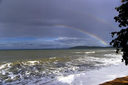 aonang: Rainbow and Sea in Krabi Province, Thailand Stock Photo