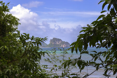 aonang: View Through Leaves of Trees to Sea. Krabi Province, Thailand Stock Photo