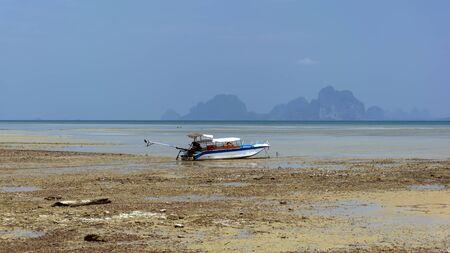 mook: Low Tide, Boat near Koh Mook Island in Trang Province. Stock Photo