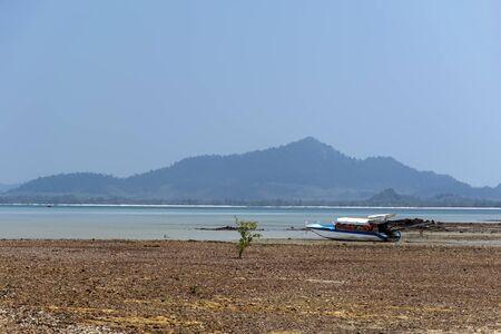 mook: Low Tide, Boat near Koh Mook Island in Trang Province Stock Photo
