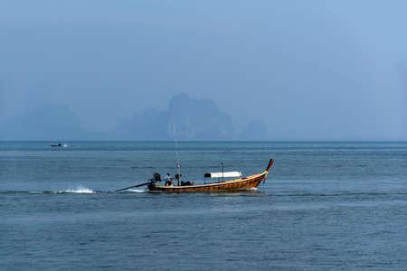 mook: Fisherman of Koh Mook Island in Trang Province, Trang, Thailand - January 22, 2015: Longtail Boat Editorial