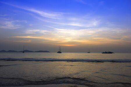 mook: Koh Mook Island Coast Line Sunset Waves Stock Photo