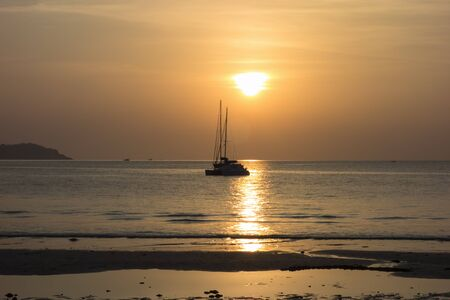 Koh Mook Island Coast Line. Catamaran on Sunset