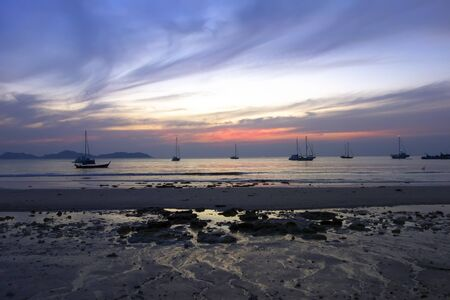 mook: Low Tide at Evening on Charlie Beach in Koh Mook Island Stock Photo