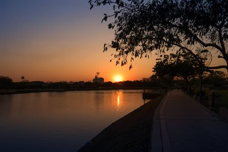 moat: Bright Sundown at Important Water in the Buri Ram Town such as Buriram Moat or Klong La Lom. Stock Photo