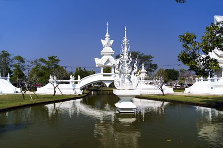 unconventional: White Bridge in Wat Rong Khun. More well-known among foreigners as the White Temple, is a contemporary unconventional Buddhist temple in Chiang Rai, Thailand.