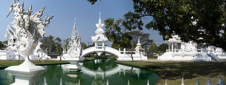 foreigners: Bridge Panorama in Wat Rong Khun. More well-known among foreigners as the White Temple, is a contemporary unconventional Buddhist temple in Chiang Rai, Thailand.