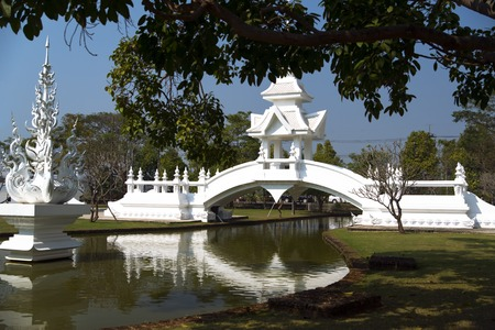 unconventional: Bridge in Wat Rong Khun. More well-known among foreigners as the White Temple, is a contemporary unconventional Buddhist temple in Chiang Rai, Thailand.