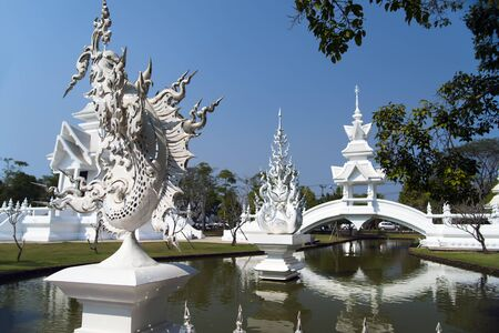 unconventional: Bridge in the Wat Rong Khun. More well-known among foreigners as the White Temple, is a contemporary unconventional Buddhist temple in Chiang Rai, Thailand.