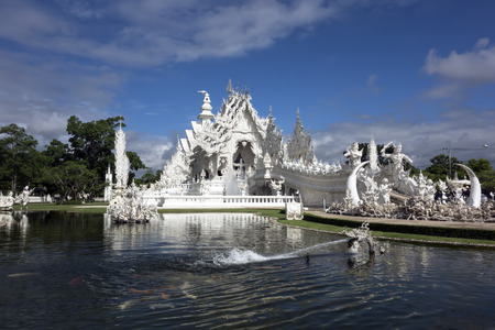 unconventional: Pond of Wat Rong Khun. More well-known among foreigners as the White Temple, is a contemporary unconventional Buddhist temple in Chiang Rai, Thailand. Stock Photo