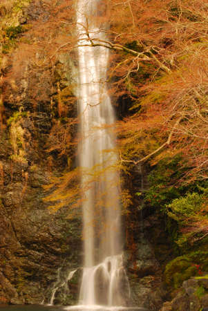 Sunset casting an orange hue on a waterfall photo