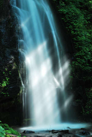 Sunlight rays shining on the Kumoi waterfall at Oirase stream, Aomori, Japan Stock Photo