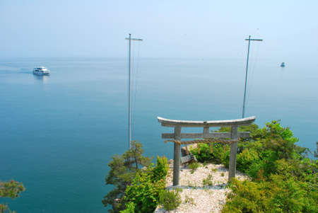 superstitions: Torii gate on an island with ships