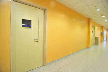 Closed doors along a lighted corridor