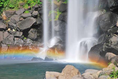 Majestic waterfall accentuated with beautiful rainbow