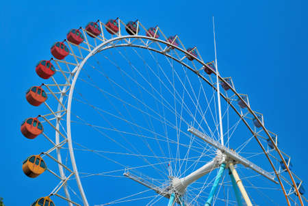 Low shot of huge and colorful ferris wheel photo