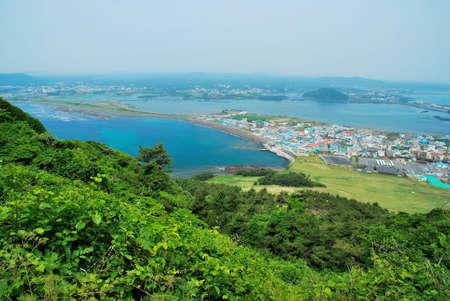 Birds eye view of Jeju island from the summit of Sunrise Peak Stock Photo