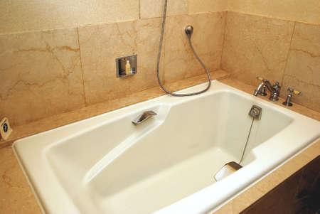 Dry, clean bathtub in a luxurious hotel room  photo