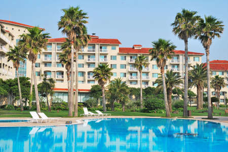 accommodations: Tropical resort hotels with beautiful pool in foreground