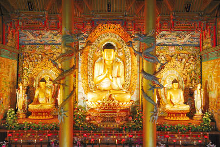Majestic golden buddha statues in Korea symbolizing faith, peace, enlightenment and eternal bliss  photo