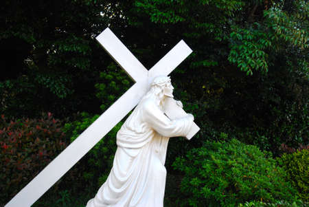 carying: Jesus Christ carying a heavy cross on his back, symbolizing the love of God, help and strong faith