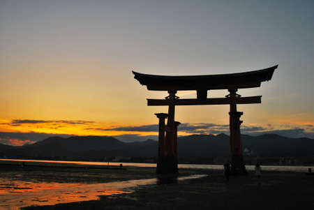 Torii gate of a temple listed as a world heritage site during sunset in Hiroshima. A symbol of religion, faith and peace