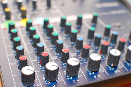 master volume: High technology equalizer or mixer used in acoustics or studio recording. Represents concepts such as technological advancement, modern lifestyle, electronic gadgets, music and studio acoustics. Stock Photo