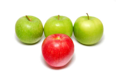 loss leader: A group of apples with a single red apple standing out from the crowd.  Stock Photo