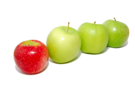 loss leader: A group of apples with a single red apple standing out from the crowd. Suitable for concepts and ideas such as outstanding, leadership qualities, individualistic, success, dare to be different, healthy eating and a healthy lifestyle. Stock Photo